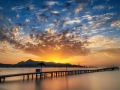 Majorca Puerto de Alcudia beach pier at sunrise in Alcudia bay in Mallorca Balearic islands of Spain